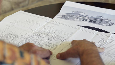 Mature Man Looking House Plan stock footage