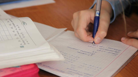 Pupil at the school writes in a notebook Live Action