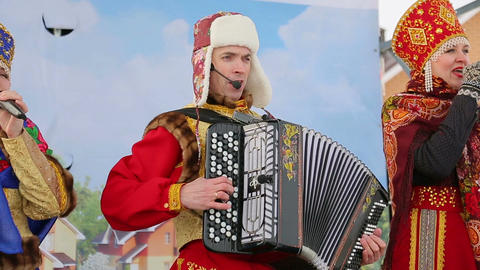 Artists with an accordion singing on stage in wint Footage
