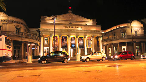 Traffic passing by the Teatro Solis in Montevideo Footage
