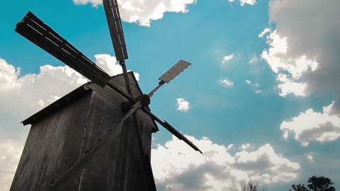 Wooden Windmill With Time Lapse Clouds In The Sky stock footage