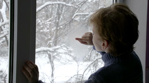 Boy in the Winter Window Footage