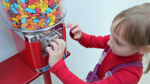 Girl pokes coin in machine sale of sweets Footage