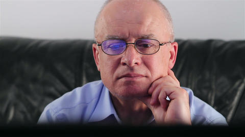 Senior Man With Glasses Watching TV stock footage