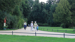 People strolling in the Muskau park Live Action