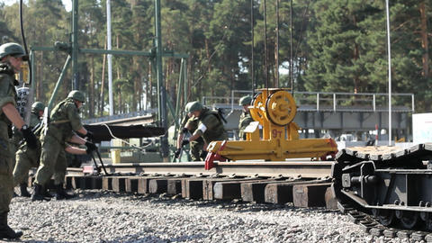 Military Men And Railroad Track Installation Machi stock footage