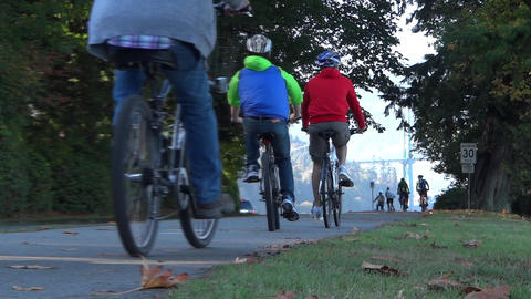 Bicyclists & Cars On Park Road stock footage