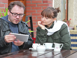 Young people with a tablet in the outdoor cafe Footage