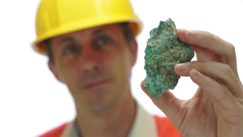 Miner Inspects Copper Carbonate Ore Live Action