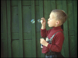 Blowing bubbles (8mm-film) Footage