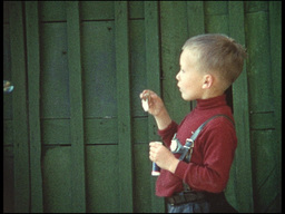 Blowing bubbles (8mm-film) Stock Video Footage