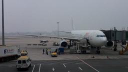 DragonAir Flight Waiting at Beijing Airport 01 Stock Video Footage