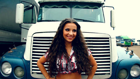Beauty Girl stand at front of truck on sunset Stock Video Footage