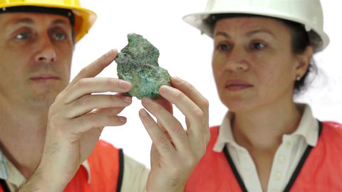 Miners Inspecting Copper Carbonate Ore Live Action