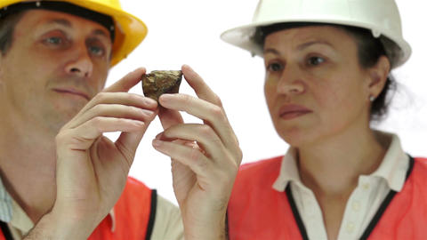 Miners Inspecting Copper Sulfide Ore Live Action