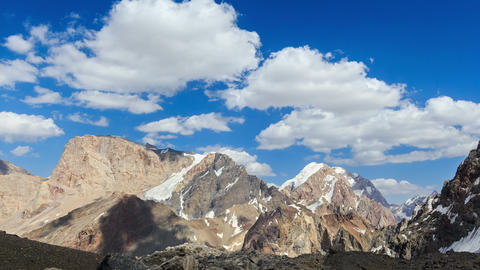 Snowy mountains in clouds. Zoom. Time Lapse. Pamir Footage