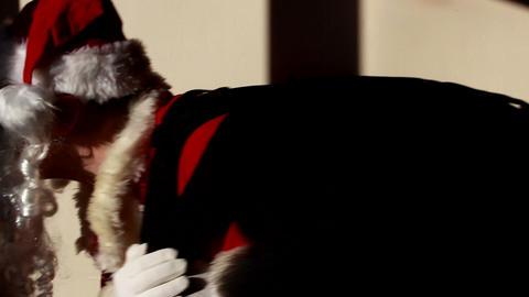 Santa Claus sneaking up in a dark room 3 Footage