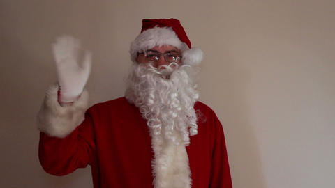 Santa Clause entering and waving his hand in greet Footage