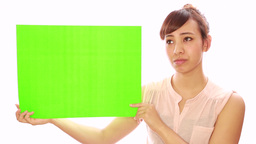 Asian Caucasian Mixed Woman Green Screen Message Board stock footage