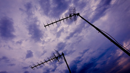 4k Analog Television Antennas On Rooftop Sunset Sk stock footage