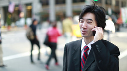 Asian Businessman Calling Talking On Cellphone In stock footage