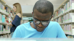Male Black College Student Reading Book In School  stock footage