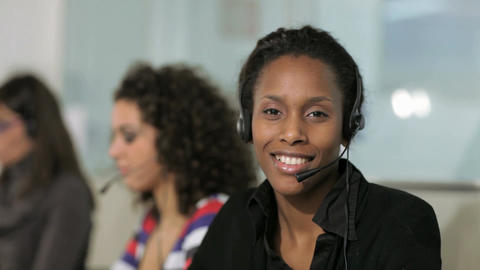 Group of women at work as customer care operators in call center GIF