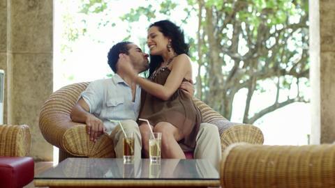 Honeymoon, just married hispanic couple sitting on chair Footage