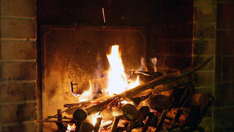 Bright flame of fire burns in an old fireplace Footage