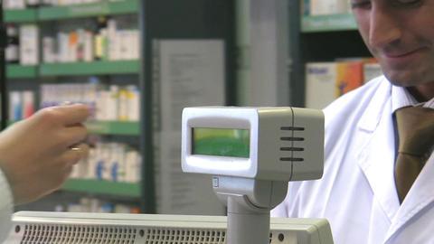Pharmacist taking euro money for prescription medi Live Action