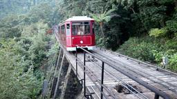 Tram climbing up a hill Footage