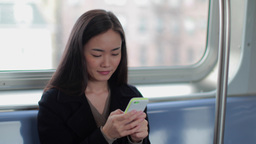 Young Asian Woman Texting Cellphone On Train stock footage