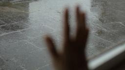 Rainy day hand on window Footage