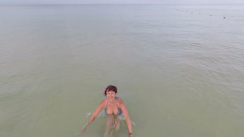 Woman in the sea. Aerial Footage