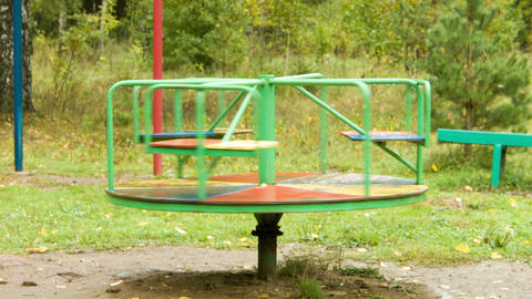 Rotation Of A Carousel In The Rain On The Empty Pl stock footage