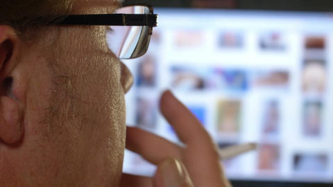 4k UHD smoking man watch nude internet conte 11572 Footage