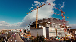 4K Urban Construction Site With Cranes Wide View H stock footage