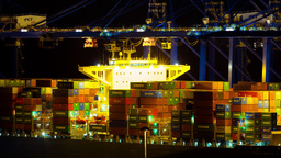 4K Cargo Container Hoisting Cranes Loading Ship Ha stock footage