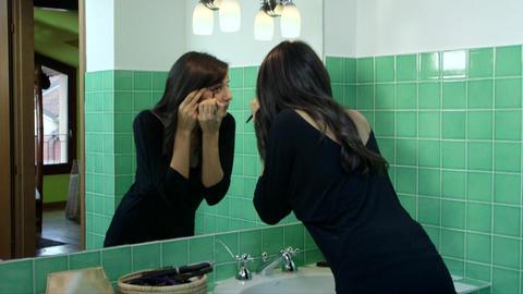 Beautiful Young Woman, Girl, Model Putting Makeup stock footage