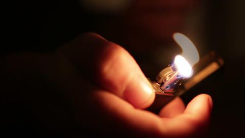 Light a cigarette lighter Live Action