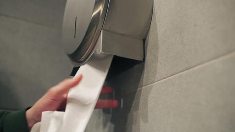 Hand takes out slowly toilet paper Footage