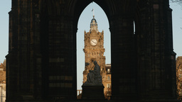 4K view of Balmoral Hotel through Scott Monument i Footage