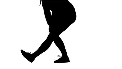 Silhouette Of Woman Stretching Her Legs stock footage