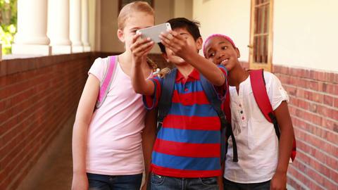 Cute pupils taking a selfie in the corridor Footage