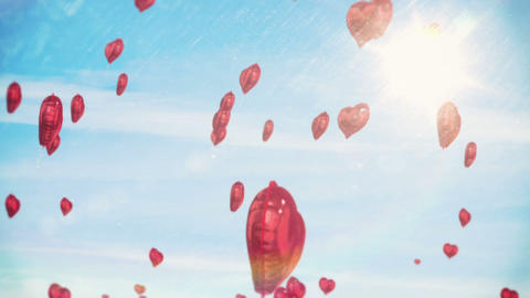 Red hearts floating against blue sky Animation