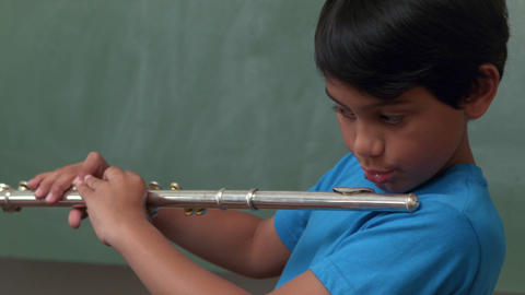 Cute Pupil Playing Flute In Classroom stock footage