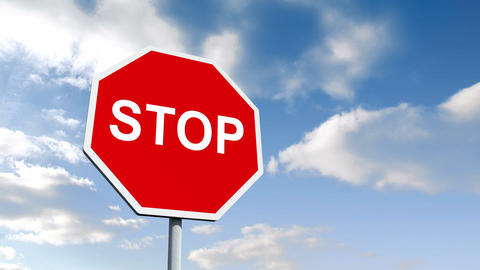 STOP road sign over cloudy sky Animation