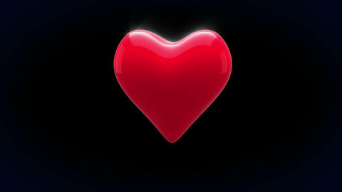 Red heart thumping on black background Videos animados