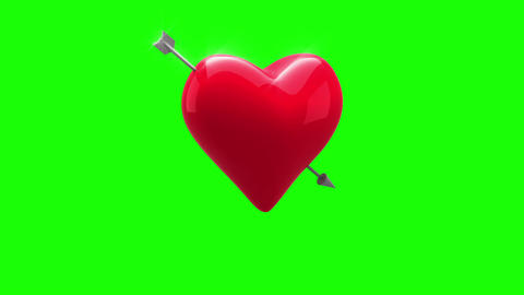 Red heart with an arrow turning on green background Animation