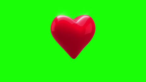 Red heart turning on green background Animation